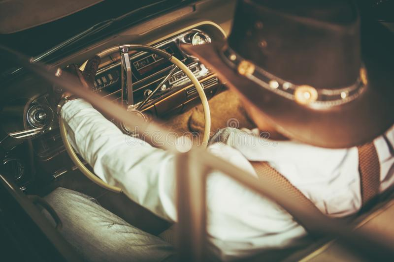 Cowboy in a Classic Car stock images