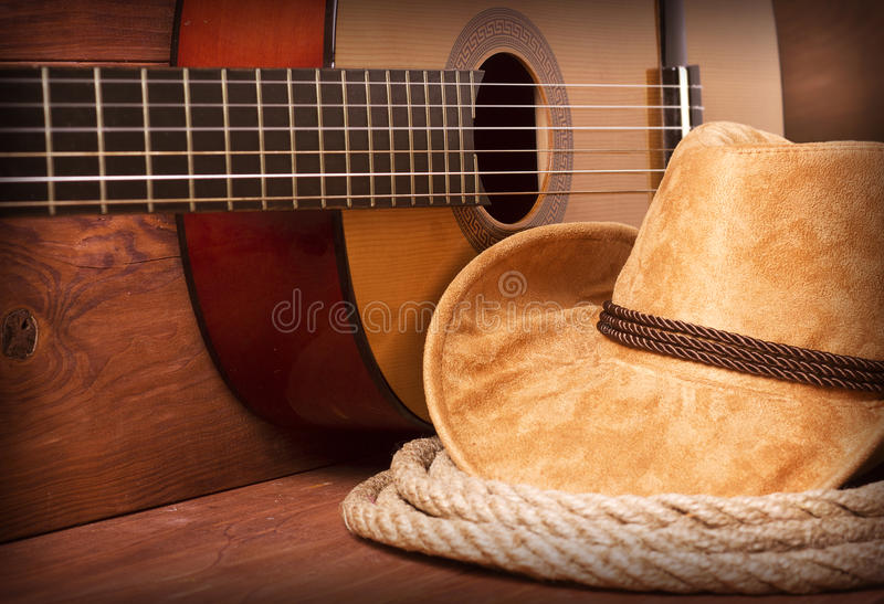 Cowboy country music. Image with guitar and american hat royalty free stock photo