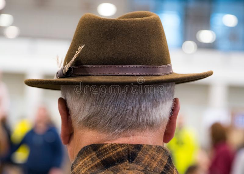 Cowboy couture. Portrait of older man wearing cowboy hat from behind royalty free stock image