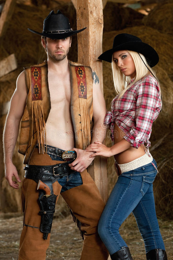 Download Cowboy and Cowgirl stock photo. Image of woman, holster - 20636194