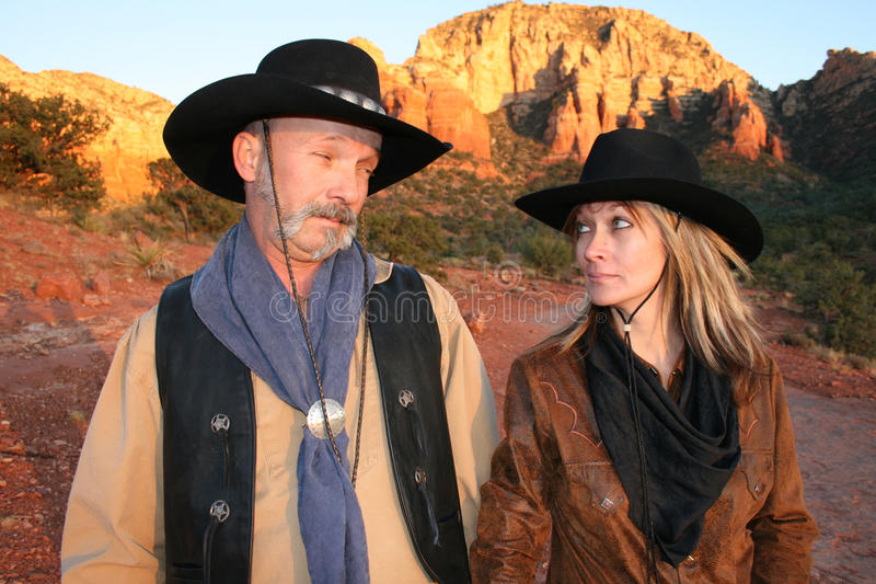 Cowboy and cowgirl looking at each other-sedona AZ stock photography