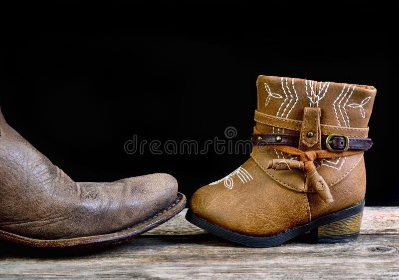 Cowboy del bambino e di papà fotografia stock
