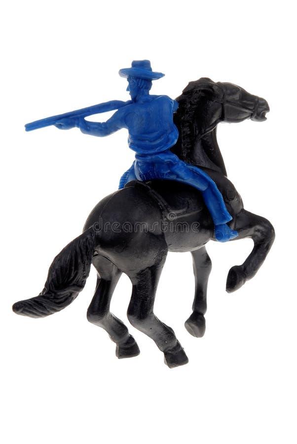 Cowboy del giocattolo sul cavallo immagine stock libera da diritti