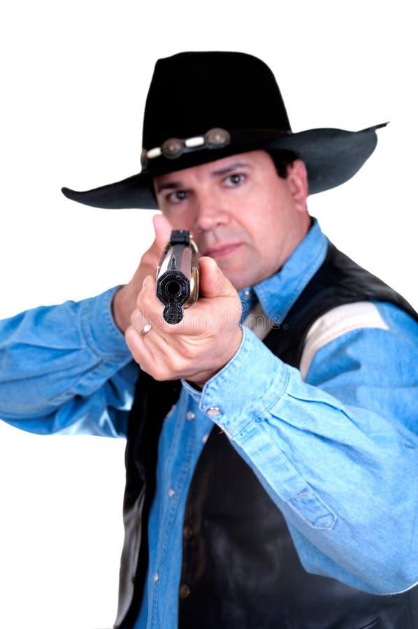 Cowboy, der ein Gewehr zeigt lizenzfreies stockbild