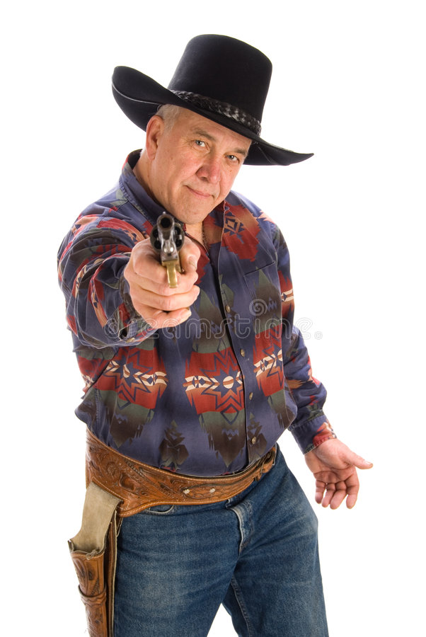 Cowboy, der Gewehr auf Kamera zeigt. lizenzfreie stockfotos