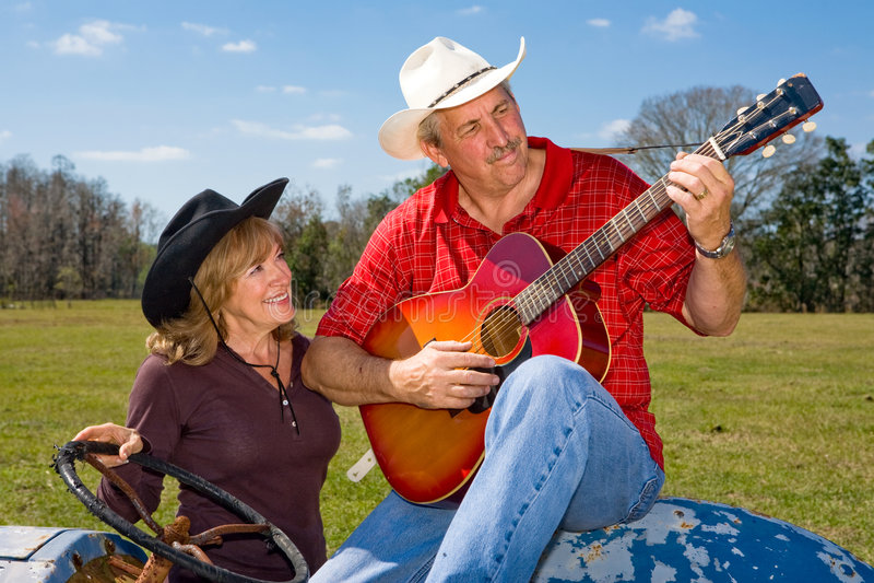 Cowboy di canto - Serenade fotografia stock libera da diritti
