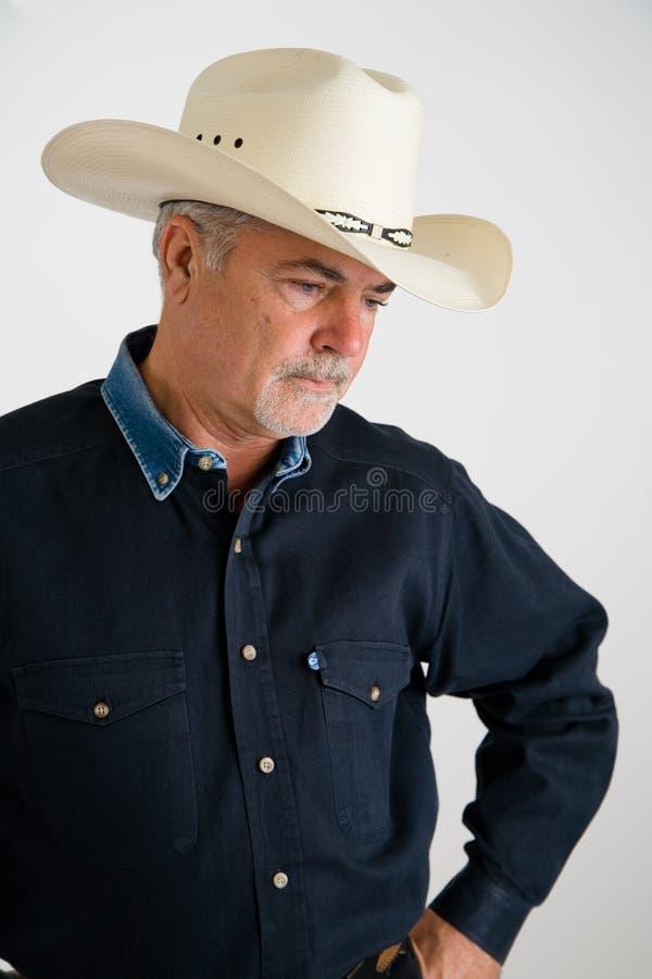 Cowboy die droevig kijkt royalty-vrije stock fotografie