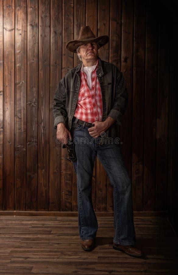 Cowboy envelhecido m?dio fotos de stock royalty free