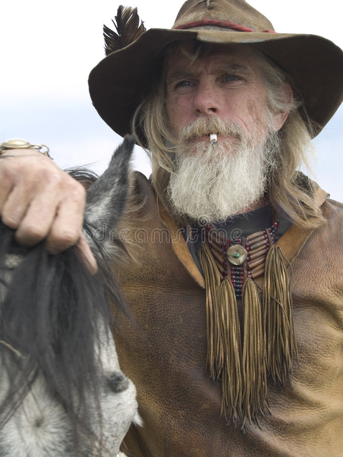 Cowboy Et Son Cheval Photo stock