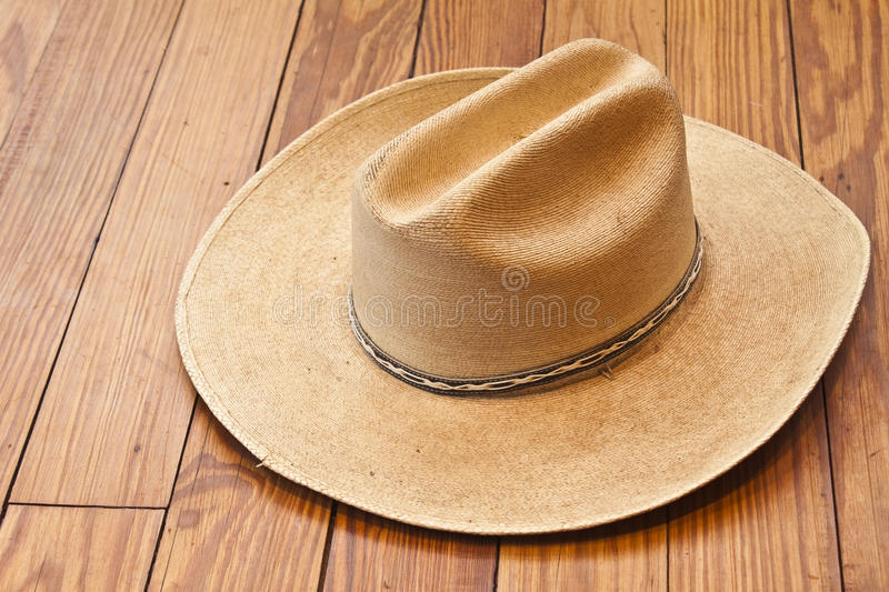 Cowboy Hat. Straw Cowboy Hat on Work Table royalty free stock photography