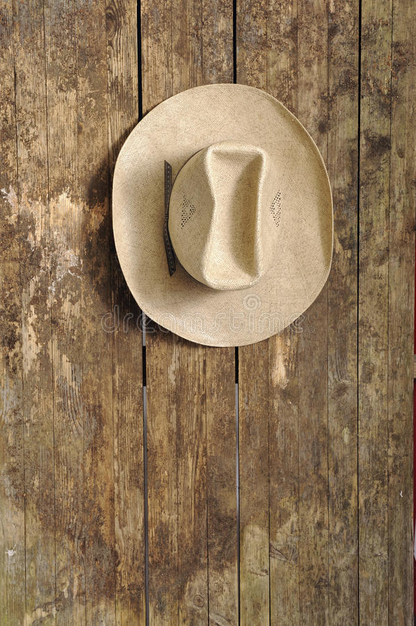 Cowboy hat hanging on an old wooden wall royalty free stock images