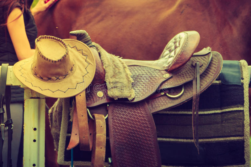 Cowboy hat, saddle, horse competition equipment. Cowboy hat, saddle strings, skirt, horse competition equipment. Taking care of animals concept royalty free stock images
