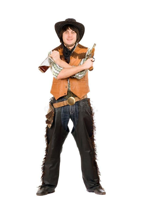 Cowboy heureux avec une bouteille et une arme à feu images libres de droits