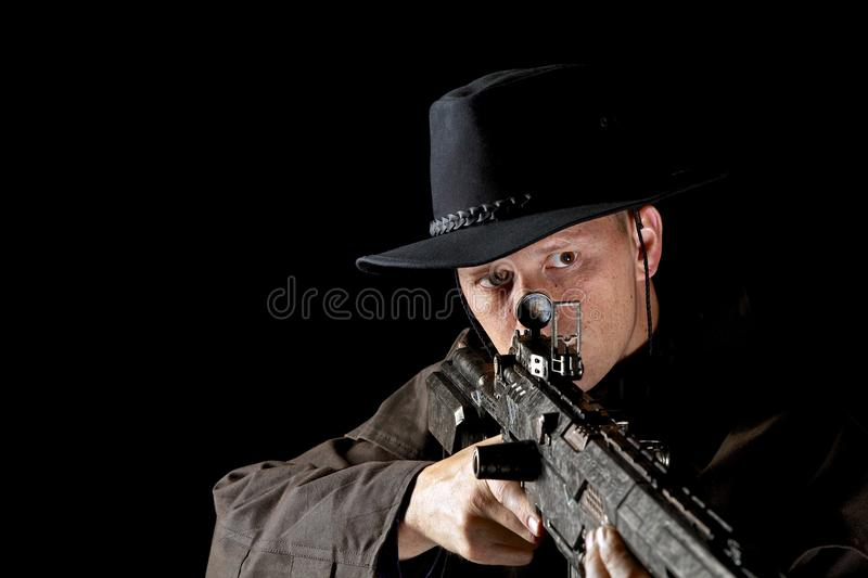 Cowboy with high powered rifle royalty free stock photography