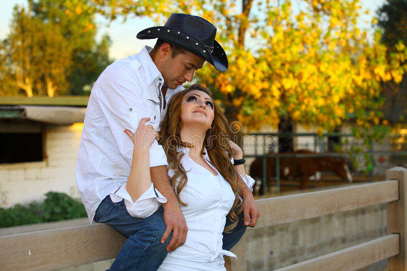 Cowboy and his Cowgirl. Affectionately holding each other stock image