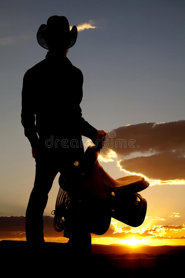 Download Cowboy Holding Saddle Silhouette Stock Photo - Image: 19176962