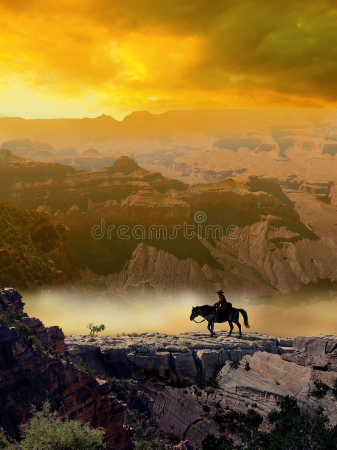 Cowboy and horse in the desert. A Cowboy crosses the Grand Canyon with his horse. The space given by the orange clouds at the top can be used to include a text royalty free illustration
