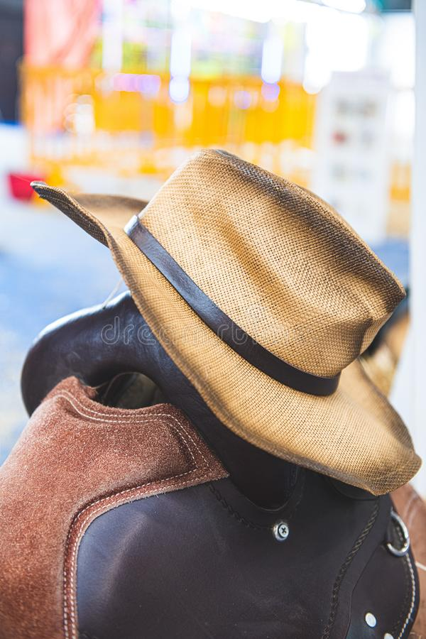 Cowboy horse riding saddle and hat personal equipment. Close-up of cowboy hat and horse saddle in a store american style riding equipment royalty free stock image