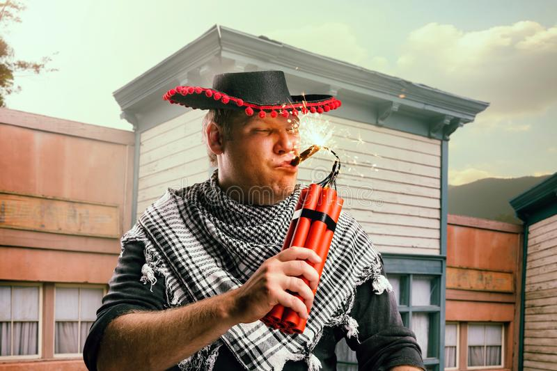 Cowboy lights a cigar from a stick of dynamite royalty free stock photos