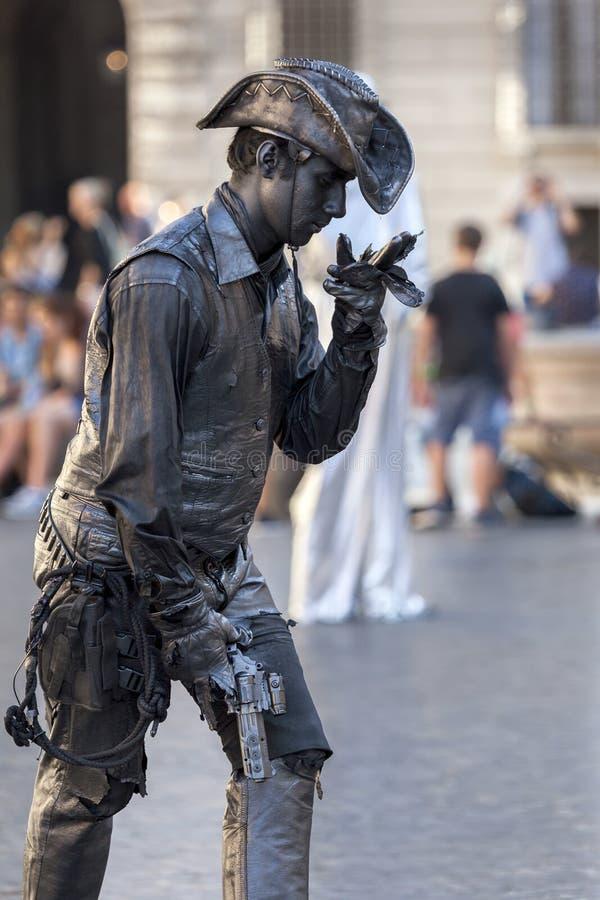 Cowboy living statue street performer stock photo