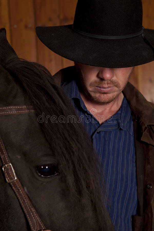 Free Cowboy Looking Down By Horse Head Royalty Free Stock Photography - 21745217
