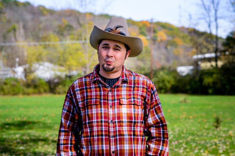 Cowboy making Wooing Face royalty free stock photography