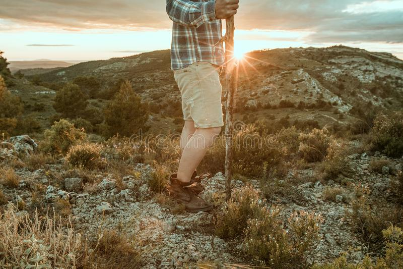 Cowboy in the mountains and a sunset. Guy Cowboy royalty free stock images