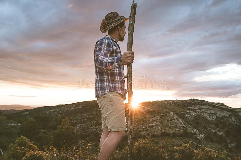 Cowboy in the mountains and a sunset. Guy Cowboy stock image