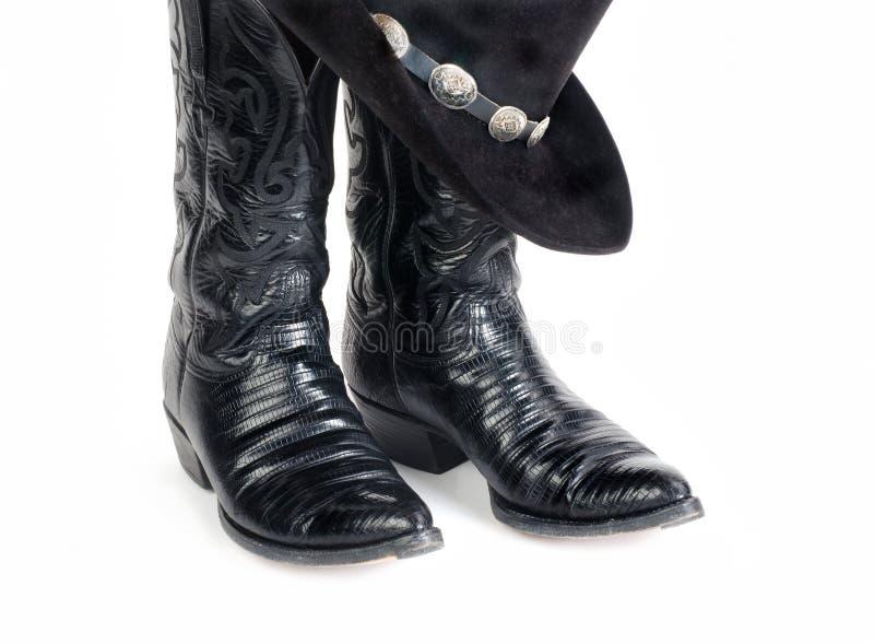 Cowboy nero Boots della lucertola e cappello con il Hatband di Concho fotografia stock libera da diritti