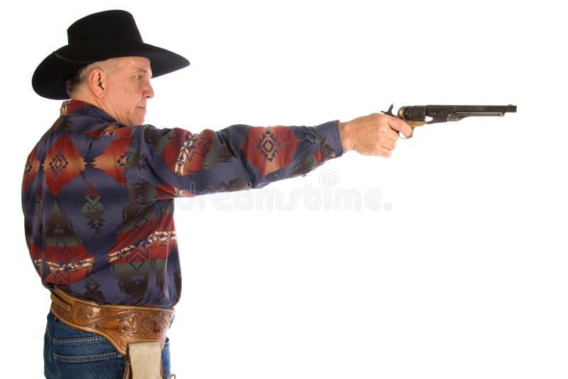 Cowboy orientant le canon. photos stock