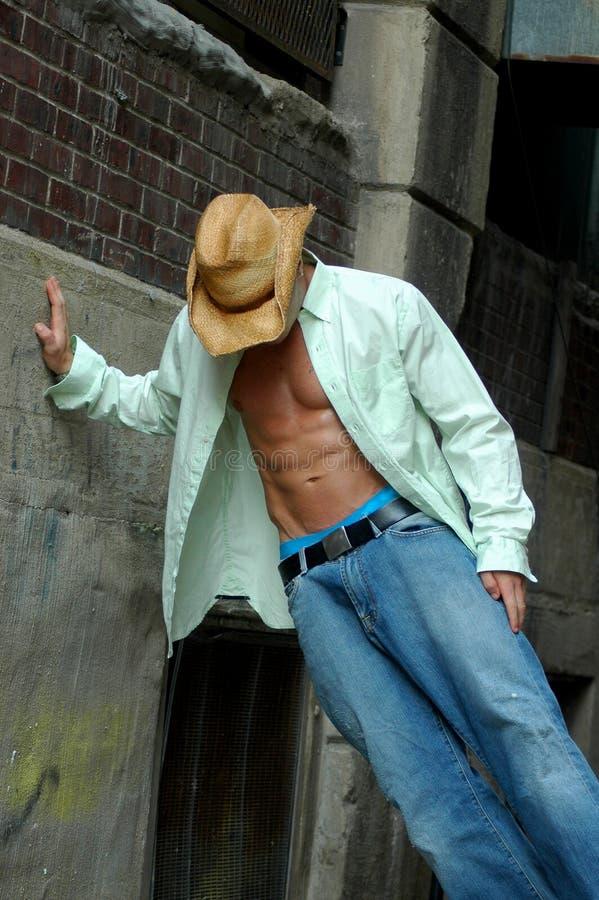 Cowboy pendente fotografia stock libera da diritti