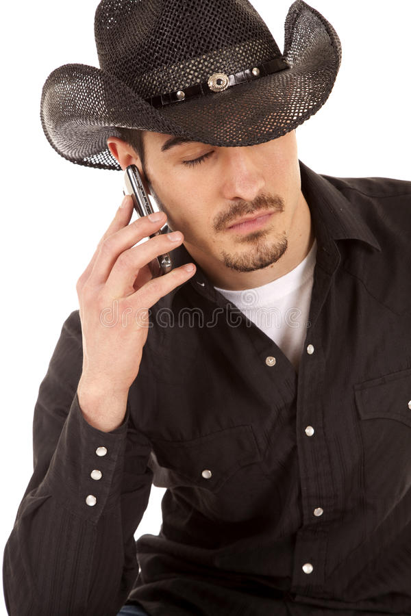 Cowboy on phone eyes closed stock photo