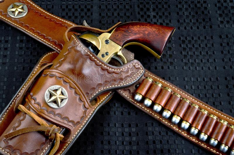 Cowboy 45 Pistol and Holster. Old cowboy 45 pistol and leather tooled holster stock image