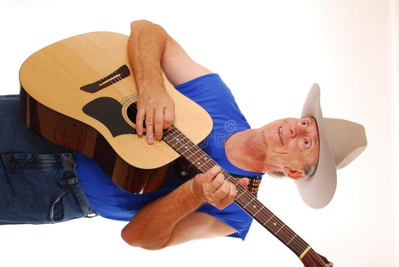 Cowboy playing guitar royalty free stock photos