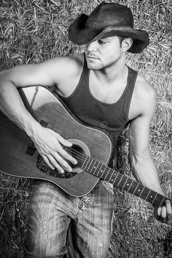 Cowboy Playing Guitar royalty free stock photography