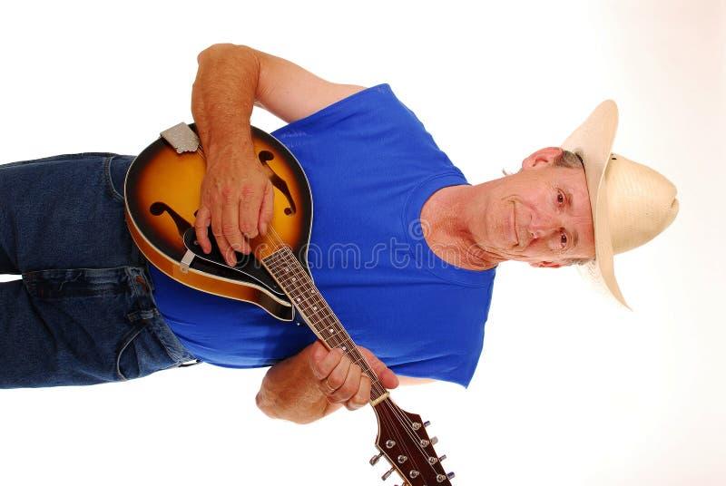 Cowboy playing mandolin stock photo