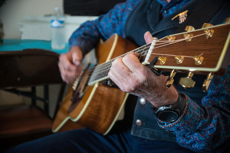 Cowboy playing western guitar royalty free stock images