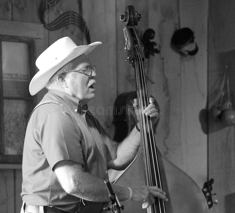 Free Cowboy Plays Bass Instrument Black And White Royalty Free Stock Images - 44315939