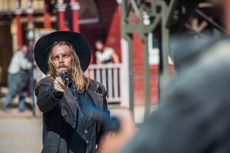Cowboy Points Gun images stock