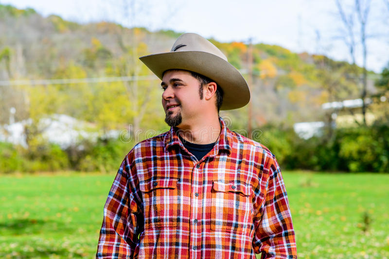 Cowboy Rancher Looking to side and smiling stock image