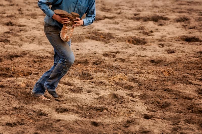 Cowboy running with a boot royalty free stock photo