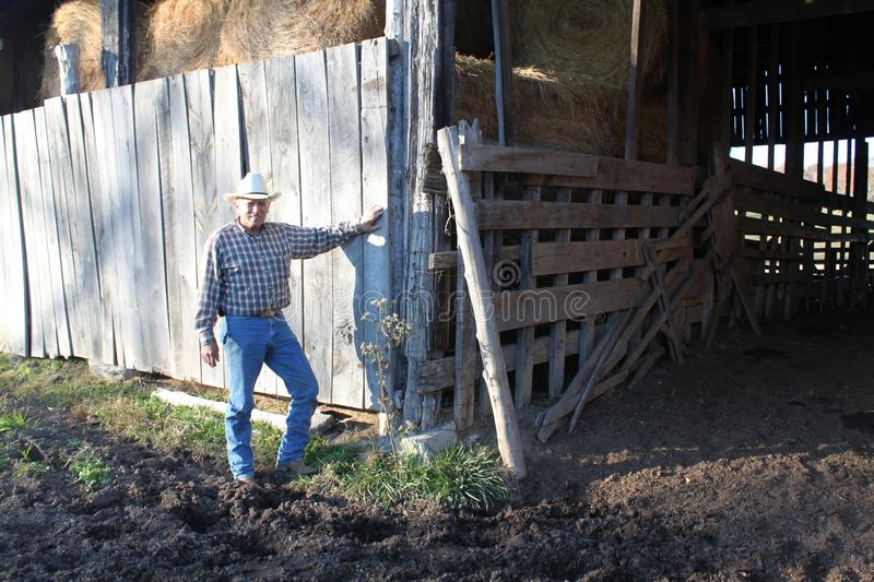 Download Cowboy By A Rustic Barn Stock Images - Image: 21966384