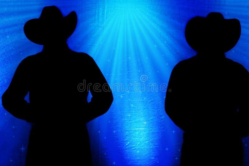 Cowboy Silhouette, fondo blu immagini stock