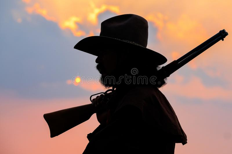 Cowboy silhouette on horse during nice sunset. Cowboy silhouette on a horse during nice sunset stock photos