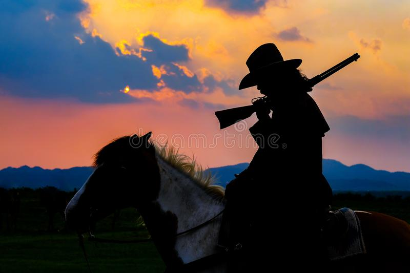 Cowboy silhouette on horse during nice sunset. Cowboy silhouette on a horse during nice sunset royalty free stock photos
