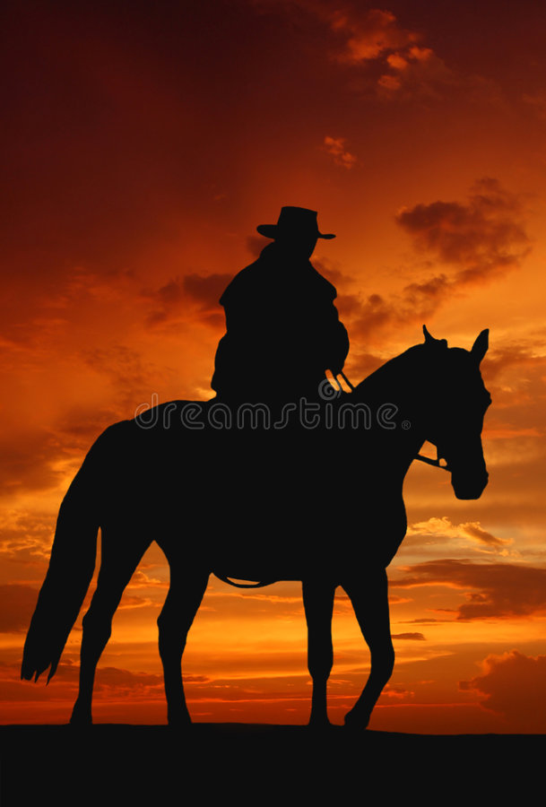 Cowboy silhouette in sunrise stock image