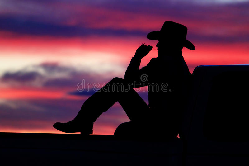 Cowboy-Sonnenuntergang lizenzfreie stockfotos