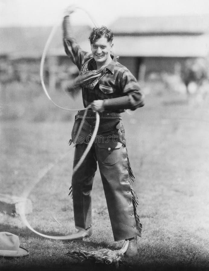 Cowboy spinnende lasso royalty-vrije stock foto's