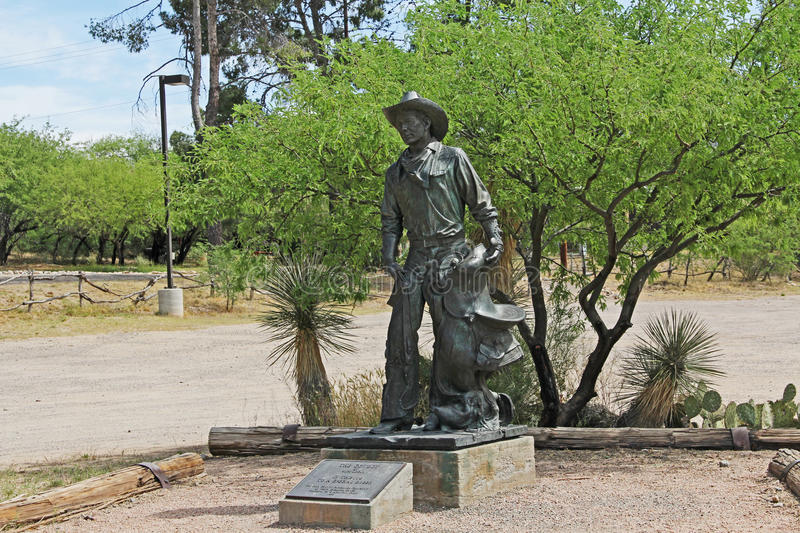 Cowboy Statue on La Posta Quemada Ranch in Colossal Cave Mountain Park. Cowboy statue, a tribute to a special breed, near the picnic area on La Posta Quemada stock photos