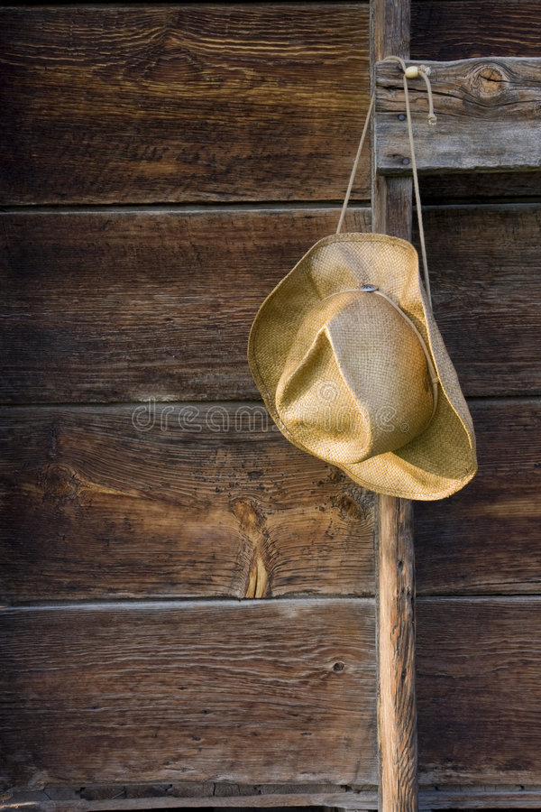 Download Cowboy Straw Hat Against Weathered Wood Stock Photo - Image: 5828712